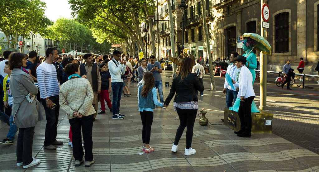 Lady in Cyan and tourist crowd on Las Ramblas, Barcelona