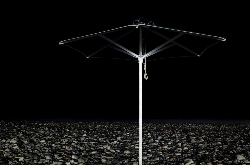 Beach umbrella at night
